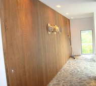NATURAL WOOD PANELED PIVOT DOOR